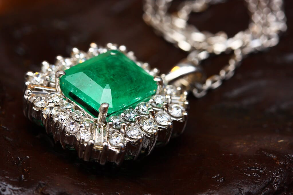 a necklace lying down for photography